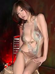 Sexy gravure idol temptress sreams it up in her skimpy swim suit
