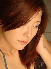 Sexy steamy asian hottie laying around in her black bikini